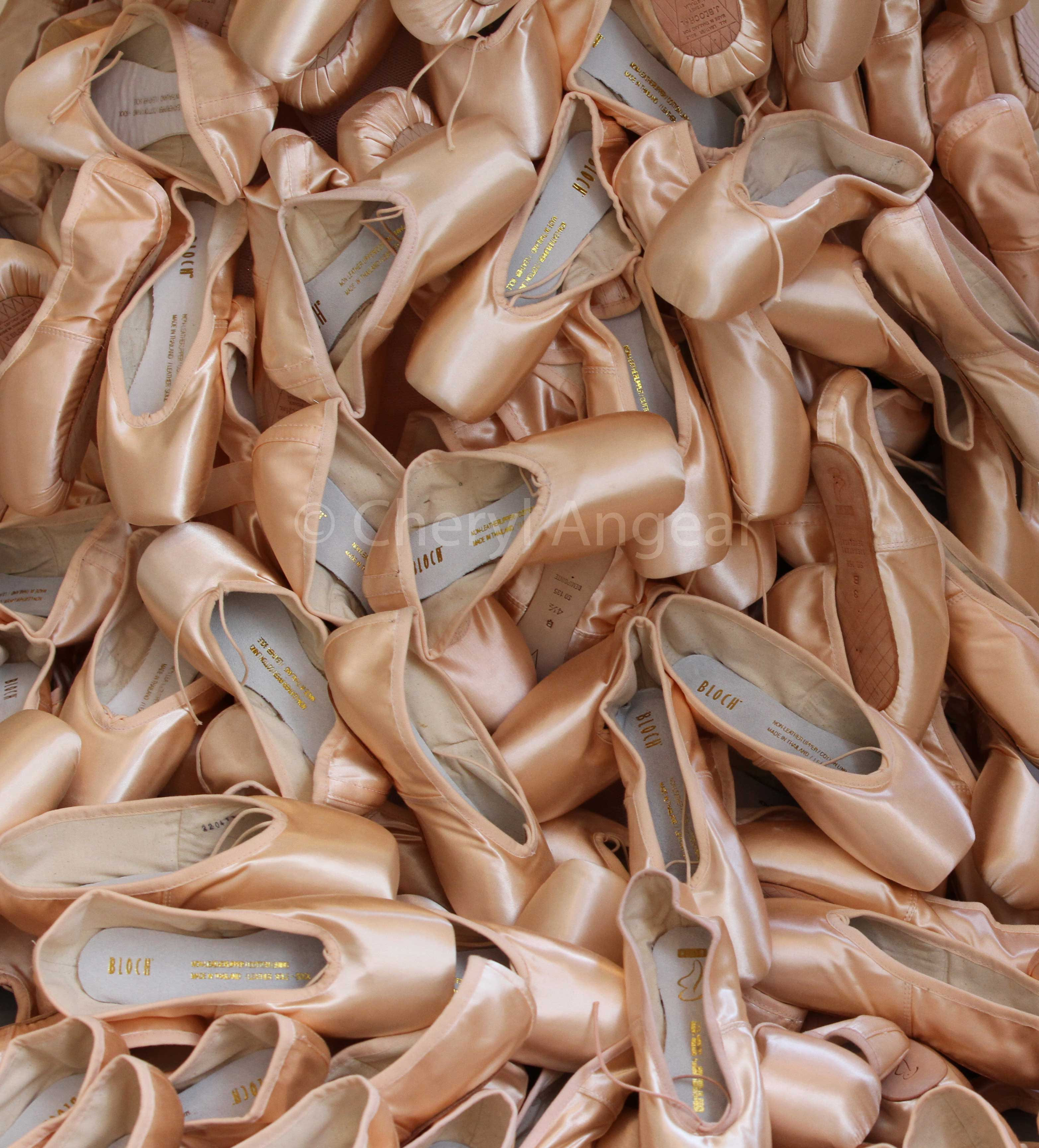 a pile of ballet pointe shoes