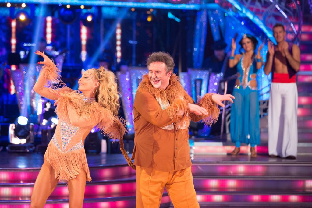 Mark and Iveta's goodbye dance with Ashley and Ola looking on in the background. Iveta Lukosiute, Mark Benton - (C) BBC - Photographer: Guy Levy