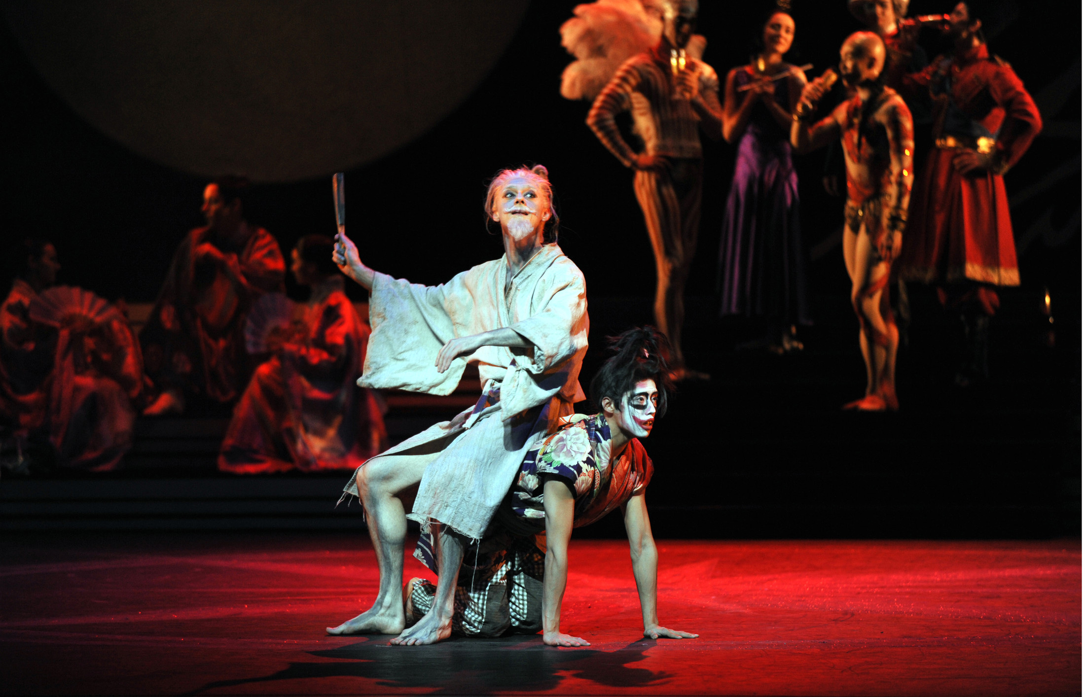 Rory Mackay as The Emperor and Tzu-Chao Chou as the Court Fool with Artist of Birmingham Royal Ballet; photo: Phil Hitchman