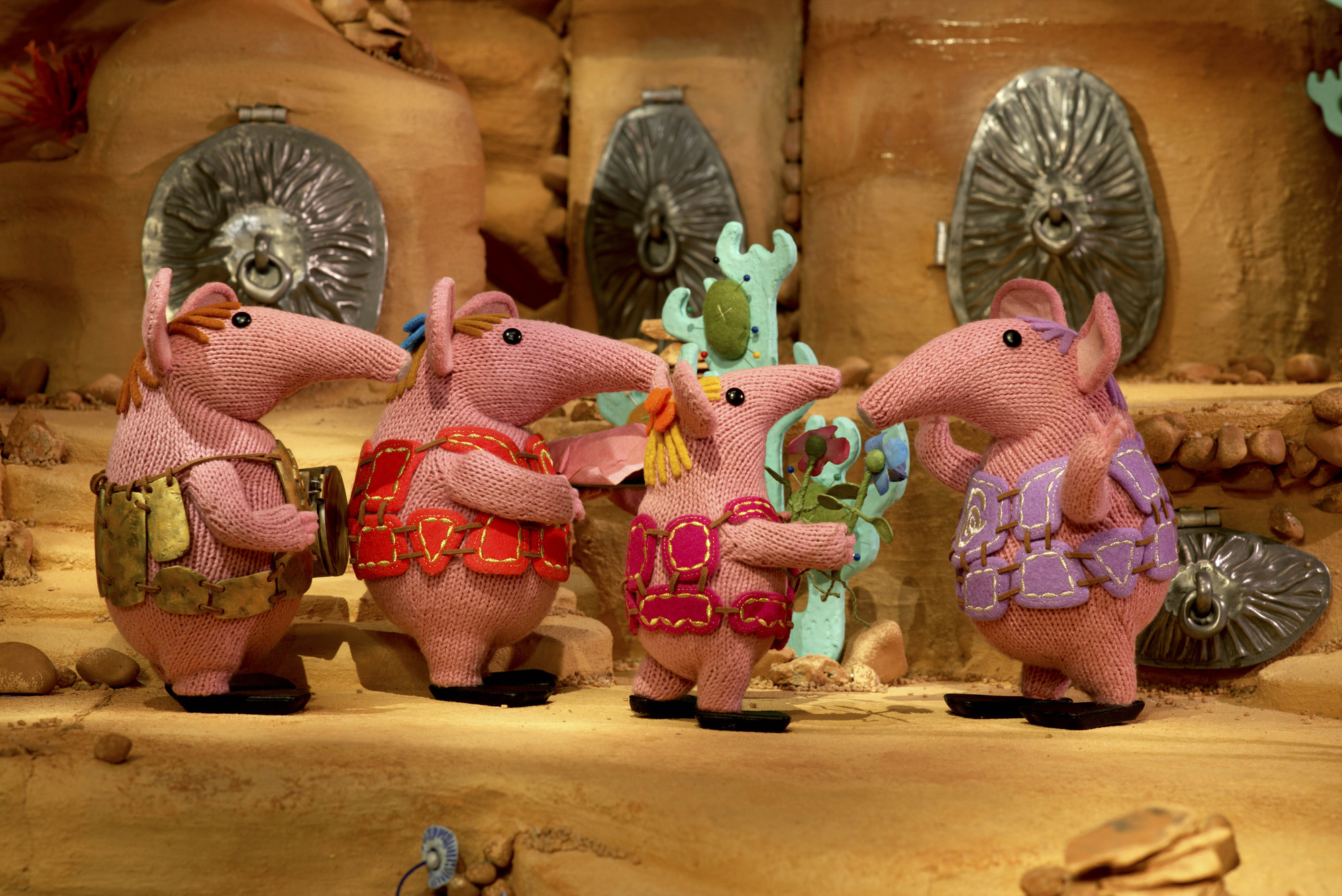 The other Clangers line up to give Granny the presents they have made for her birthday. Major, Mother, Tiny, Granny - (C) Coolabi, Smallfilms and Peter Firmin - Photographer: Production