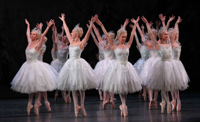 ballet dancers on pointe dressed as snowflakes