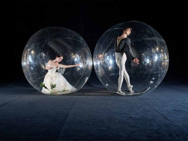 Two ballet dancers socially distanced on stage